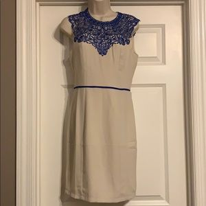 Great cream color dress with blue lace